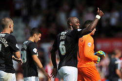 Charlton Athletic's Andre Bikey gives a thumbs up to the crowd after the match - Photo mandatory by-line: Patrick Khachfe/JMP - Mobile: 07966 386802 09/08/2014 - SPORT - FOOTBALL - Brentford - Griffin Park - Brentford v Charlton Athletic - Sky Bet Championship - First game of the season