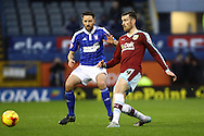 David Jones of Burnley (r) passes the ball while under pressure from Cole Skuse of Ipswich Town. Skybet football league Championship match, Burnley v Ipswich Town at Turf Moor in Burnley, Lancs on Saturday 2nd January 2016.<br /> pic by Chris Stading, Andrew Orchard sports photography.