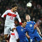 Turkey's Mehmet Topal (L) and Slovakia's Bakos (C) during their a international friendly soccer match Turkey betwen Slovakia at Ataturk stadium in Bursa February 29, 2012. Photo by TURKPIX
