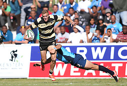 Logan Basson of Boland is tackled by Ulrich Beyers of the Blue Bulls during the Currie Cup premier division match between the Boland Cavaliers and The Blue Bulls held at Boland Stadium, Wellington, South Africa on the 23rd September 2016<br /> <br /> Photo by:   Shaun Roy/ Real Time Images