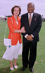 MR & MRS TREVOR McDONALD, he is the newsreader, at a polo match in Berkshire on 27th July 1997.MAR 5