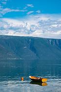 A small wooden boat moored on Sogne Fjord, Vestlandet, Norway