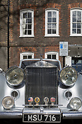 A 1954 Rolls-Royce Silver Dawn is parked in Smith Square, a small square behind the Houses of Parliament, before collecting its VIP passengers - barristers who are being sworn in as QCs (aka Silks in legal vernacular), on 11th March 2019, in London, England.