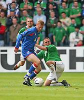 Photo: Andrew Unwin.<br />Northern Ireland v Iceland. European Championships 2008 Qualifying. 02/09/2006.<br />Northern Ireland's David Healy (R) looks to tackle Iceland's Brynjar Bjorn Gunnarsson (L).