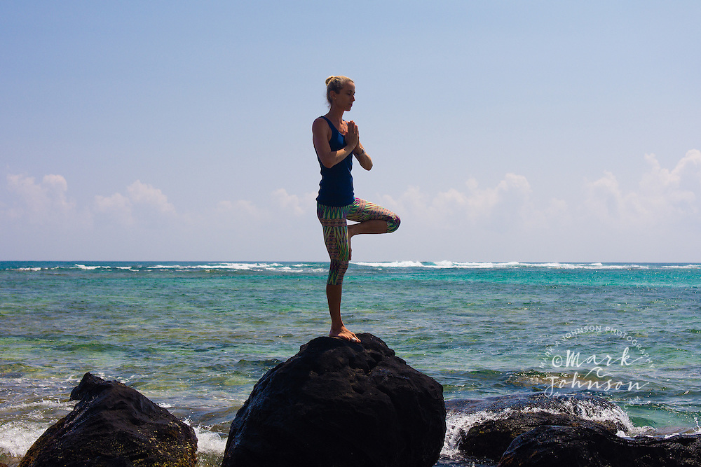 Woman doing yoga on the beach, Hawaii people ****Model Release available