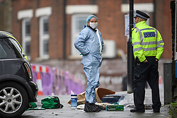 © Licensed to London News Pictures. 24/11/2019. London, UK. Police forensics at the scene where a man has been found stabbed to death outside a west London train station in what is being reported as a road rage incident. The attack follows a stabbing in Whitechapel on Saturday, in which another man in his 20s was killed. Photo credit: Ben Cawthra/LNP