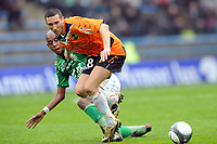 FOOTBALL - FRENCH CHAMPIONSHIP 2009/2010 - L1 - FC LORIENT v AS SAINT ETIENNE - 28/03/2010 - PHOTO PASCAL ALLEE / DPPI - MORGAN AMALFITANO (FCL) / GELSON (ASSE)