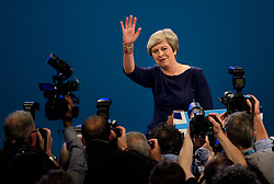 © Licensed to London News Pictures. 04/10/2017. Manchester, UK. British prime minister THERESA MAY waves to the crowd after delivering her leaders speech on the final day of the Conservative Party Conference. The four day event is expected to focus heavily on Brexit, with the British prime minister hoping to dampen rumours of a leadership challenge. Photo credit: Ben Cawthra/LNP