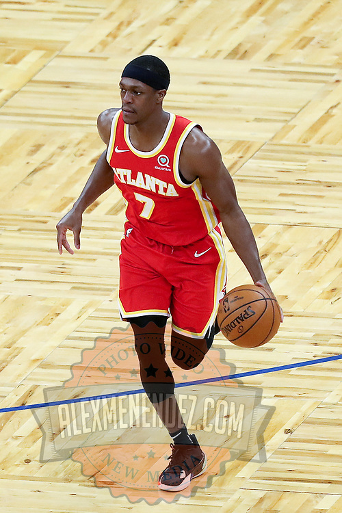 ORLANDO, FL - MARCH 03: Rajon Rondo #7 of the Atlanta Hawks controls the ball against the Orlando Magic at Amway Center on March 3, 2021 in Orlando, Florida. NOTE TO USER: User expressly acknowledges and agrees that, by downloading and or using this photograph, User is consenting to the terms and conditions of the Getty Images License Agreement. (Photo by Alex Menendez/Getty Images)*** Local Caption *** Rajon Rondo