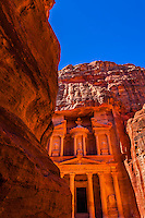 Looking from The Siq (gorge) to The Treasury (Al-Khazneh), Petra Archaeological Park (a UNESCO World Heritage Site), Petra, Jordan.