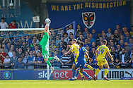 AFC Wimbledon goalkeeper Aaron Ramsdale (35) making save in front of AFC Wimbledon sign that says we are the resurrrection during the EFL Sky Bet League 1 match between AFC Wimbledon and Bristol Rovers at the Cherry Red Records Stadium, Kingston, England on 19 April 2019.