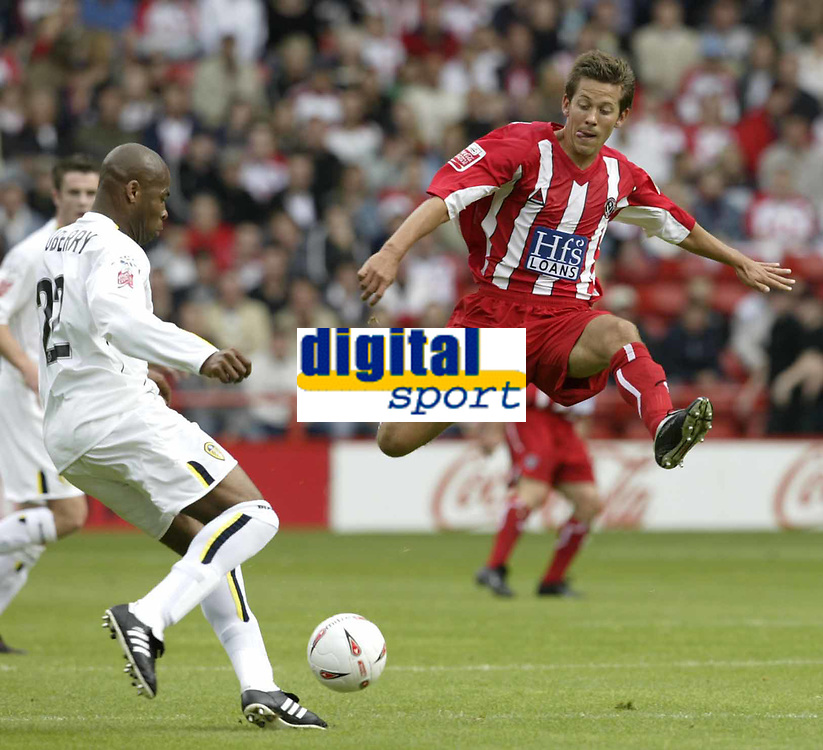 Fotball<br /> Foto: Fotosports/Digitalsport<br /> NORWAY ONLY<br /> <br /> Date: 29/08/2004<br /> <br /> Sheffield United v Leeds United<br /> Coca Cola Championship<br /> <br /> Sheffield 's John Harley jumps out of the way from a Leeds Michael Duberry clearence