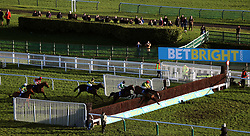 Jockey Barry Cooper on Sizing Tennessee leads the field during the Betbright Dipper Novices' Chase