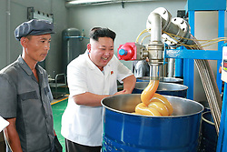 Undated photo from North Korean News Agency shows North Korean leader Kim Jong-un laughing as he visits a lubricant factory, in Pyongyang, North Korea. Photo released in August 2014. Photo by Balkis Press/ABACAPRESS.COM