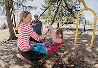 Peyton Hoyt and Kami Lamarre take a wild ride on the tire swing with Erik Hoyt at Leavitt Park on Sunday afternoon.  (Karen Bobotas/for the Laconia Daily Sun)
