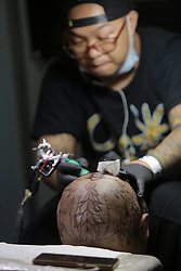 September 1, 2017 - Pasay City, Philippines - An artist tattoos a customer's head during the annual Dutdutan Philippine Tattoo Expo 2017 in Pasay City. The Expo is an annual event where acclaimed tattoo artists and enthusiasts gather to witness and participate in tattoo competitions. (Credit Image: © Rouelle Umali/Xinhua via ZUMA Wire)