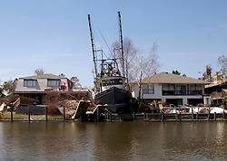 08 Sept 2005.  New Orleans, Louisiana. Hurricane Katrina aftermath. <br /> Venetian Isles in East New Orleans, where the tidal surge washed over the land and devastated homes and property. A shrimp boat rests between residential houses.<br /> Photo; ©Charlie Varley/varleypix.com