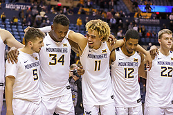 Dec 1, 2019; Morgantown, WV, USA; West Virginia Mountaineers players celebrate after defeating the Rhode Island Rams at WVU Coliseum. Mandatory Credit: Ben Queen-USA TODAY Sports