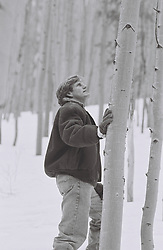 Man in the snow by Aspen Trees In New Mexico