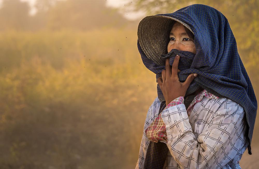 BAGAN, MYANMAR - CIRCA DECEMBER 2013: Portrait of burmese woman, a farmer from a village in the afternoon near Bagan in Myanmar