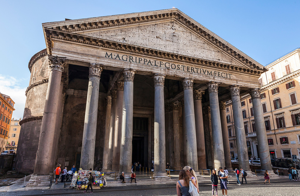 Tourists and guides in front of the Patheon in central Rome, Italy. The Pantheon is a former Roman temple and now a church completed in 126 AD