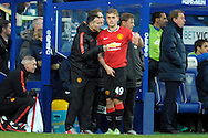 Ryan Giggs, Manchester United Assistant Manger talking to James Wilson of Manchester United on the touch line before he comes on as a replacement. Barclays Premier league match, Queens Park Rangers v Manchester Utd at Loftus Road in London on Saturday 17th Jan 2015. pic by John Patrick Fletcher, Andrew Orchard sports photography.
