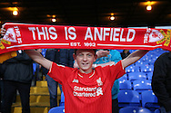 a Liverpool fan looks on holding his scarf before k/o. Premier League match, Crystal Palace v Liverpool at Selhurst Park in London on Saturday 29th October 2016.<br /> pic by John Patrick Fletcher, Andrew Orchard sports photography.
