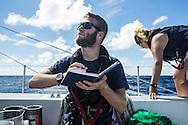 North Atlantic Ocean, October 2014.<br /> Marine biologist Adam Porter takes notes, on board the Sea Dragon.  © Chiara Marina Grioni
