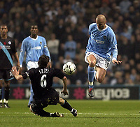 Picture: Henry Browne.<br />Date: 09/11/2003.<br />Manchester City v Leicester City  FA Barclaycard Premiership.<br />Antoine Siberski of Man City skips a challenge from Leicester's Muzzy Izzet