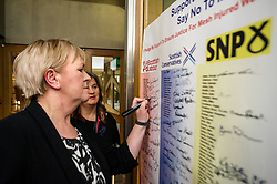 Pictured: Johann Lamont, MSP, signs the pledge watched by Claire Daisley<br /> Thousands of Scottish women have been fitted with polypropylene transvaginal mesh to treat pelvic organ prolapse or stress urinary incontinence. As a result women in every Scottish constituency have been severely injured or permanently disabled following this procedure, some have lost organs, many their careers and their relationships.  The women and their families  are asking MSPs to sign a pledge <br /> <br /> Ger Harley | EEm 16 March 2017