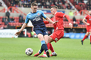 Woking midfielder Christian Jolley (6) battles for possession  during the The FA Cup 2nd round match between Swindon Town and Woking at the County Ground, Swindon, England on 2 December 2018.