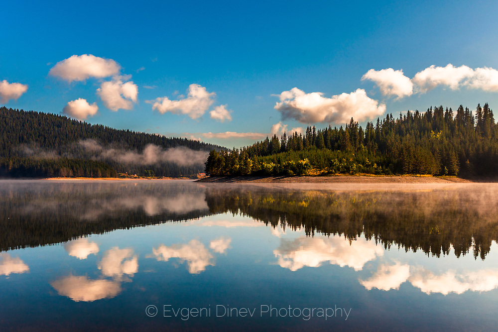 Reflections of white clouds in the lake