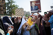 Women show their support for detained president Mohammed Morsi at a pro-government rally in Cairo.