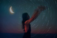 Woman and the cosmos photo illustration,