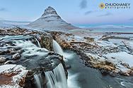 Wintry waterfall below Kirkjufell aka Church Mountain on the Snaefellsnes Peninsula in western Iceland