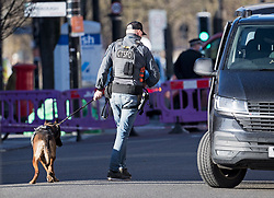 © Licensed to London News Pictures. 22/01/2021. London, UK. A Counter Terrorism Specialist Firearm Officer (CFSFO) with a dog, at the scene where police are involved in a standoff with a man reported to be in possession of a firearm at a residential address in Southhall, west London. Photo credit: Ben Cawthra/LNP