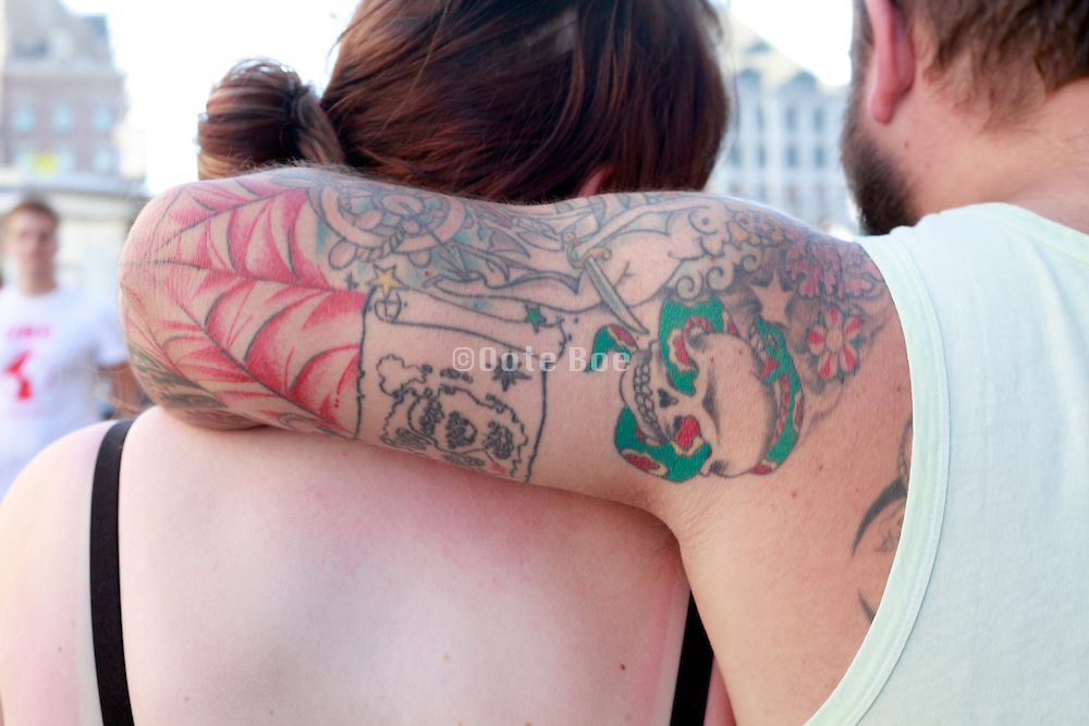 couple with man tattoo's on his arm