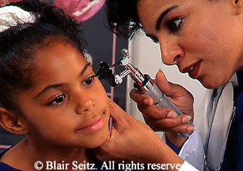 doctor, physician at work African American Child Patient, Black Female Doctor, Family Pactice