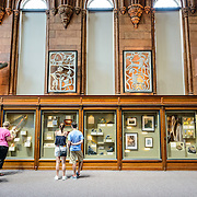 Smithsonian Castle Exhibits in West Wing. Formally known as the Smithsonian Institution Building, the Smithsonian Castle houses the administrative headquarters fo the Smithsonian Institution as well as some a permanent exhibition titled Smithsonian Institution: America's Treasure Chest. It's distinctive architectural style stands out on the southern side of the National Mall in Washington DC.