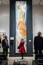 "© Licensed to London News Pictures. 24/06/2015. London, UK.   Visitors look at Robert Delaunay's ""La ville de Paris, la femme et la tour eiffel"", at the preview of Masterpiece London, the international cross-collecting Fair for art, antiques and design which takes place at The Royal Hospital Chelsea 25 June to 1 July. Photo credit : Stephen Chung/LNP"