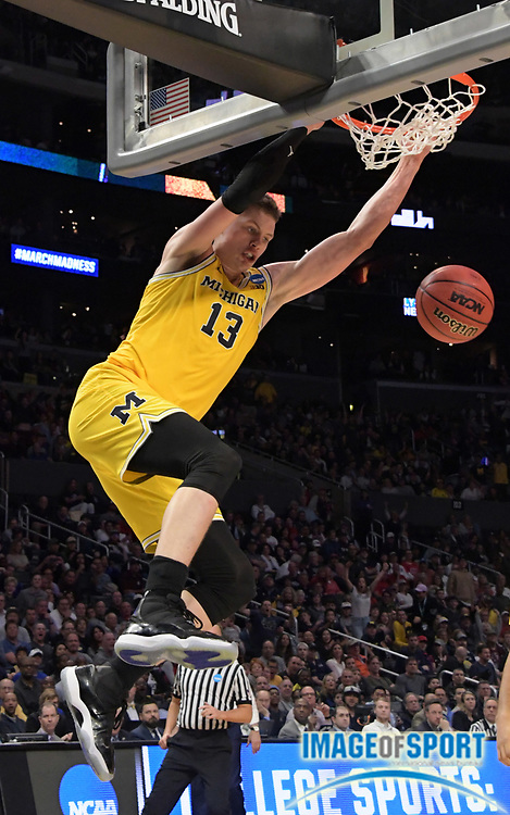 Michigan Wolverines forward Moritz Wagner (13) dunks the ball in the first half against the Texas A&M Aggies during a West Regional semifinal of the NCAA men's college basketball tournament, Thursday, March 22, 2018, in Los Angeles. Michigan defeated Texas A&M 99-72.
