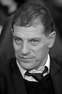 Note : image has been converted to black & white. West Ham United manager Slaven Bilic looks on from the dugout before k/o. Barclays Premier league match, Tottenham Hotspur v West Ham Utd at White Hart Lane in London on Sunday 22nd November 2015.<br /> pic by John Patrick Fletcher, Andrew Orchard sports photography.