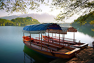 Picture image photo of the traditional transportation to Bled Island which is a wooden boat known as a pletna. The word pletna is a borrowing from Bavarian German Plätten 'flat-bottomed boat'. Some sources claim the pletna was used in Lake Bled as early as 1150 AD, but most historians date the first boats to 1590 AD. Lake Bled Slovania<br /> <br /> Visit our PHOTO COLLECTIONS OF SLOVANIAN  HISTOIC PLACES for more photos to download or buy as wall art prints https://funkystock.photoshelter.com/gallery-collection/Pictures-Images-of-Slovenia-Photos-of-Slovenian-Historic-Landmark-Sites/C0000_BlKhcYWnT4Sites/C0000qxA2zGFjd_k