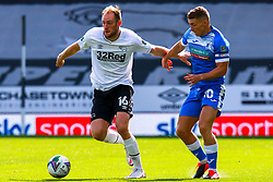 Matt Clarke of Derby County holds off pressure  from Lewis Hardcastle of Barrow - Mandatory by-line: Ryan Crockett/JMP - 05/09/2020 - FOOTBALL - Pride Park Stadium - Derby, England - Derby County v Barrow - Carabao Cup