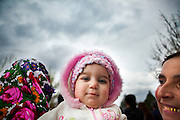 This one year baby girl is assisting to the fair for the first time. Her mother was married at 14th. Each spring in Mogila, Bulgaria, is celebrated the Gypsy Bride Market. In this festival the virginity is for sale. The honor can be bought. Every girl has a price to be agreed between the parents of the girl and the candidate. The price can range between 1.500 and 10.000€, in a country where the minimum salary is just over 100€. The market joins the Kalajdzii families, known as the thracians tinkerers, whose tradition is still alive. Many girls dress as real princesses, others prefer to dress in a modern way. They dance during hours the ring dance while grandparents and parents watch the way the young interrelate. Many girls dream to be married by the rite imposed by the tradition. Nowadays there are some girls that don't agree with the tradition and would prefer not to marry, although they assist to these market all the times. Divorces and elopements, so far taboo, are becoming everytime more frequent. Beyond the topic, ethnologists, define it as the Kalajdzii's disco, where the family honor is involved in a commercial transaction. This ritual has being celebrated for years, so anthropologists think is not going to change too much in future.