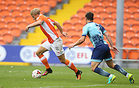 Blackpool's Brad Potts shields the ball from Wycombe Wanderers' Joe Jacobson<br /> <br /> Photographer Stephen White/CameraSport<br /> <br /> Football - The EFL Sky Bet League Two - Blackpool v Wycombe Wanderers - Saturday 20 August 2016 - Bloomfield Road - Blackpool<br /> <br /> World Copyright © 2016 CameraSport. All rights reserved. 43 Linden Ave. Countesthorpe. Leicester. England. LE8 5PG - Tel: +44 (0) 116 277 4147 - admin@camerasport.com - www.camerasport.com