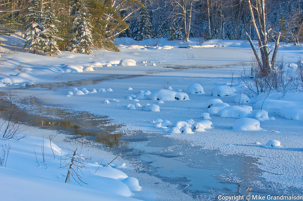 Ice along a creek in winter. Muskoka Country.<br />