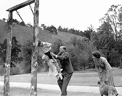 File photo dated 14/09/55 of Prince Charles and Princess Anne being pushed on a swing by the Duke of Edinburgh, watched by Queen Elizabeth II, in the grounds of Balmoral. The Royal couple will celebrate their platinum wedding anniversary on November 20.