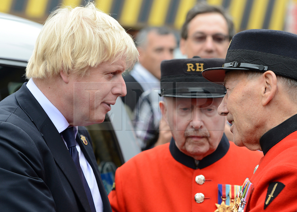 © Licensed to London News Pictures. 02/05/2012. London, UK Boris Johnston listens to a Chelsea Pensioners story. London Mayor,Boris Johnsonis joined bycomedian Al Murrayto wave off an army ofWWII veterans who are embarking on an iconic trip to the Netherlands, via a convoy of black cabs.The London Taxi Benevolent Association for the War Disabled has organised a trip for 160 WWII veterans to travel to Holland in 80 London Black Cabs. The veterans, mostly aged between 85 and 94, will start their journey from London today 2nd May 2012 and will be visiting sites of importance from WWII and taking part in Dutch Liberation Day celebrations as guests of honour of the Dutch Royal Family.. Photo credit : Stephen Simpson/LNP