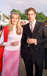 MR HUGH VAN CUTSEM jnr and LADY LOUISE FITZROY,<br />  at the Chelsea Flower show in London on 22nd May 2000.OEJ 63